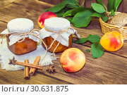 Купить «Food, harvest, canned fruit. Spicy peach jam homemade jam in a glass jar of fresh ripe fruits cinnamon on a wooden background in a rustic style», фото № 30631875, снято 9 сентября 2018 г. (c) Светлана Евграфова / Фотобанк Лори