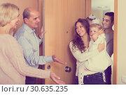 Mature people welcoming dear guests. Стоковое фото, фотограф Яков Филимонов / Фотобанк Лори