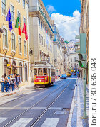 Купить «One of the most famous and historical electric tram of No. 28 running on the fancy street. Lisbon, Portugal», фото № 30636043, снято 15 июля 2018 г. (c) Николай Коржов / Фотобанк Лори