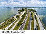 Купить «Automobile car rest area on I-275 the southern part of the causeway that connects Palmetto / Bradenton Florida to St. Petersburg Florida via the Sunshine Skyway Bridge.», фото № 30637427, снято 9 ноября 2018 г. (c) age Fotostock / Фотобанк Лори