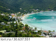 Купить «Beach on Tortola is the largest of the British Virgin Islands in the Caribbean. It features several white-sand beaches, including Cane Garden Bay and Smugglerâ...», фото № 30637551, снято 20 января 2019 г. (c) age Fotostock / Фотобанк Лори