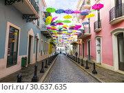 Купить «Colorful Umbrellas of downtown San Juan, Puerto Rico s capital and largest city, sits on the island's Atlantic coast. Its widest beach fronts the Isla...», фото № 30637635, снято 23 января 2019 г. (c) age Fotostock / Фотобанк Лори