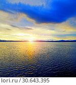 Купить «Sea sunset landscape. Sea water surface lit by soft sunlight. Summer sunny water scene in picturesque tones», фото № 30643395, снято 26 августа 2013 г. (c) Зезелина Марина / Фотобанк Лори