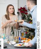 Купить «Couple cleaning table after Christmas dinner», фото № 30643707, снято 15 января 2019 г. (c) Яков Филимонов / Фотобанк Лори