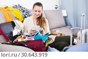 Купить «Young female choosing resort or ticket online», фото № 30643919, снято 21 марта 2017 г. (c) Яков Филимонов / Фотобанк Лори