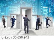 Купить «Businessman in uncertainty concept with many doors», фото № 30650943, снято 18 июня 2019 г. (c) Elnur / Фотобанк Лори