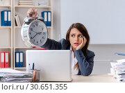 Купить «Beautiful female employee unhappy with excessive work», фото № 30651355, снято 16 ноября 2018 г. (c) Elnur / Фотобанк Лори