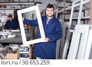 Купить «active male professional labours with finished PVC profiles and windows», фото № 30653259, снято 30 марта 2017 г. (c) Яков Филимонов / Фотобанк Лори