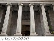 Купить «Low angle view of architectural columns, New York City, New York State, USA», фото № 30653627, снято 28 апреля 2016 г. (c) Ingram Publishing / Фотобанк Лори
