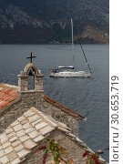 Купить «Bell tower of church with a boat in the Bay of Kotor, Montenegro», фото № 30653719, снято 9 сентября 2017 г. (c) Ingram Publishing / Фотобанк Лори