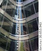 Купить «Reflection of skyscraper on the glass of another building, New York City, New York State, USA», фото № 30653943, снято 13 декабря 2019 г. (c) Ingram Publishing / Фотобанк Лори