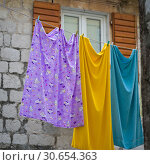 Купить «Cloth hanging on a line, Perast, Bay of Kotor, Montenegro», фото № 30654363, снято 23 октября 2019 г. (c) Ingram Publishing / Фотобанк Лори