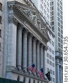 Купить «Low angle view of New York Stock Exchange building, Wall Street, Lower Manhattan, New York City, New York State, USA», фото № 30654735, снято 22 мая 2019 г. (c) Ingram Publishing / Фотобанк Лори
