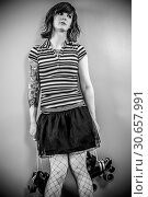 Bored roller derby woman. Стоковое фото, фотограф sumners / easy Fotostock / Фотобанк Лори