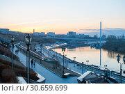 Купить «Tyumen, Russia, on April 19, 2019: The embankment in Tyumen in the evening», фото № 30659699, снято 19 апреля 2019 г. (c) Землянникова Вероника / Фотобанк Лори