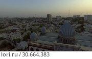 Купить «Съёмка с дрона мечети в Душанбе. Таджикистан.», видеоролик № 30664383, снято 31 июля 2016 г. (c) kinocopter / Фотобанк Лори