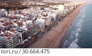 Купить «Aerial view of coast at Calafell cityscape with a modern apartment buildings, Spain», видеоролик № 30664475, снято 10 марта 2019 г. (c) Яков Филимонов / Фотобанк Лори