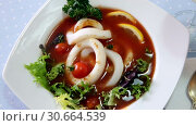 Dish of Mediterranean cuisine - tomato soup with squid and greens. Стоковое видео, видеограф Яков Филимонов / Фотобанк Лори
