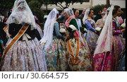 Купить «Costumed procession in colorful traditional dresses in city streets on annual spring Falles festival», видеоролик № 30664575, снято 18 марта 2019 г. (c) Яков Филимонов / Фотобанк Лори