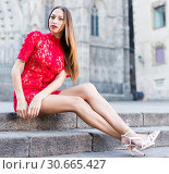 Купить «portrait of young adult girl in evening apparel sitting in european town», фото № 30665427, снято 24 июня 2017 г. (c) Яков Филимонов / Фотобанк Лори