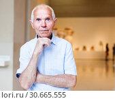Купить «Man observing museum exposition», фото № 30665555, снято 9 июня 2018 г. (c) Яков Филимонов / Фотобанк Лори