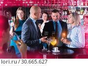 Купить «Men and woman at corporate party», фото № 30665627, снято 25 марта 2019 г. (c) Яков Филимонов / Фотобанк Лори