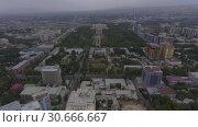 Купить «Съёмки с дрона центра Душанбе, Таджикистан», видеоролик № 30666667, снято 3 августа 2016 г. (c) kinocopter / Фотобанк Лори