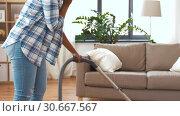 Купить «african american woman with vacuum cleaner at home», видеоролик № 30667567, снято 15 апреля 2019 г. (c) Syda Productions / Фотобанк Лори