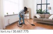 Купить «african american woman with vacuum cleaner at home», видеоролик № 30667775, снято 15 апреля 2019 г. (c) Syda Productions / Фотобанк Лори