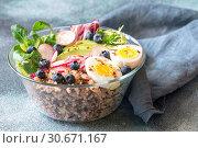 Купить «Bowl of wild rice with avocado, egg and lettuce», фото № 30671167, снято 25 февраля 2018 г. (c) easy Fotostock / Фотобанк Лори