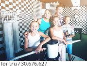 Купить «Smiling family is visiting of escaperoom», фото № 30676627, снято 3 августа 2017 г. (c) Яков Филимонов / Фотобанк Лори