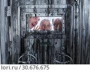 Купить «Portrait of a mad family behind a closed door», фото № 30676675, снято 3 августа 2017 г. (c) Яков Филимонов / Фотобанк Лори