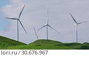 Купить «Wind turbines with blue sky on farm field», видеоролик № 30676967, снято 29 апреля 2019 г. (c) Алексей Кузнецов / Фотобанк Лори