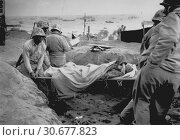 Купить «PACIFIC OCEAN Iwo Jima -- 23 Feb 1945 -- Carrying a Japanese prisoner from stockade to be evacuated and treated for malnutrition during the invasion of...», фото № 30677823, снято 23 мая 2012 г. (c) age Fotostock / Фотобанк Лори
