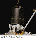 Купить «EARTH -- May 1992 -- Three STS-49 crewmembers hold onto the 4. 5-ton Intelsat VI satellite in May 1992 after a six-handed 'capture' was made minutes earlier...», фото № 30677863, снято 22 мая 2019 г. (c) age Fotostock / Фотобанк Лори