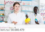 Купить «Apothecary female recommending medicinal product», фото № 30680479, снято 2 марта 2018 г. (c) Яков Филимонов / Фотобанк Лори