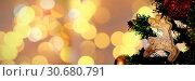 Купить «Composite image of defocused of christmas tree lights and fireplace», фото № 30680791, снято 23 октября 2019 г. (c) Wavebreak Media / Фотобанк Лори
