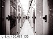 Купить «Empty server room», фото № 30681135, снято 7 июля 2020 г. (c) Wavebreak Media / Фотобанк Лори