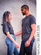 Купить «Hipster couple with blank t-shirts for your design», фото № 30681539, снято 17 сентября 2019 г. (c) Wavebreak Media / Фотобанк Лори