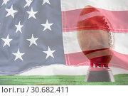 Купить «Composite image of american football on tee against white background», фото № 30682411, снято 21 июля 2019 г. (c) Wavebreak Media / Фотобанк Лори