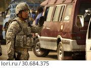 Купить «IRAQ Baghdad -- 31 Jul 2008 -- US Army Staff Sgt Conrad Vasquez directs traffic near a checkpoint on a road leading into Baghdad, Iraq -- Picture by Daniel Herrera / Lightroom Photos / US Army.», фото № 30684375, снято 20 мая 2019 г. (c) age Fotostock / Фотобанк Лори