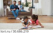 Купить «happy family spending free time at home», видеоролик № 30686219, снято 8 апреля 2019 г. (c) Syda Productions / Фотобанк Лори