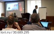 Купить «Audience listens to the lecturer at the conference», видеоролик № 30689295, снято 4 апреля 2020 г. (c) Антон Гвоздиков / Фотобанк Лори