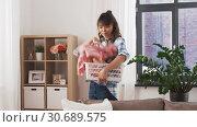 Купить «asian woman picking dirty laundry at home», видеоролик № 30689575, снято 25 апреля 2019 г. (c) Syda Productions / Фотобанк Лори