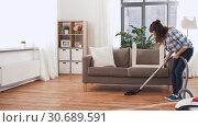 Купить «asian woman with vacuum cleaner at home», видеоролик № 30689591, снято 25 апреля 2019 г. (c) Syda Productions / Фотобанк Лори