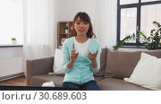 Купить «asian female blogger recording video blog at home», видеоролик № 30689603, снято 25 апреля 2019 г. (c) Syda Productions / Фотобанк Лори