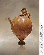 Terra cotta Hittite beaker shaped side spouted pitcher with lid - 1700 BC to 1500BC - Kültepe Kanesh - Museum of Anatolian Civilisations, Ankara, Turkey, Against a warm art background. (2019 год). Редакционное фото, фотограф Funkystock / age Fotostock / Фотобанк Лори
