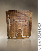 Phrygian inlayed Wooden Screen from the Gordion Great Tumulus. Phrygian Collection, 8th-7th century BC - Museum of Anatolian Civilisations Ankara. Turkey. Against an art background. (2019 год). Редакционное фото, фотограф Funkystock / age Fotostock / Фотобанк Лори