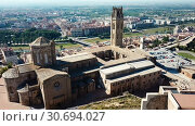 Купить «View from drone of Catalan city of Lleida with medieval Cathedral of St. Mary of La Seu Vella», видеоролик № 30694027, снято 25 июля 2018 г. (c) Яков Филимонов / Фотобанк Лори