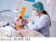 Купить «Young handsome man visiting female doctor cosmetologist», фото № 30695183, снято 16 ноября 2017 г. (c) Elnur / Фотобанк Лори